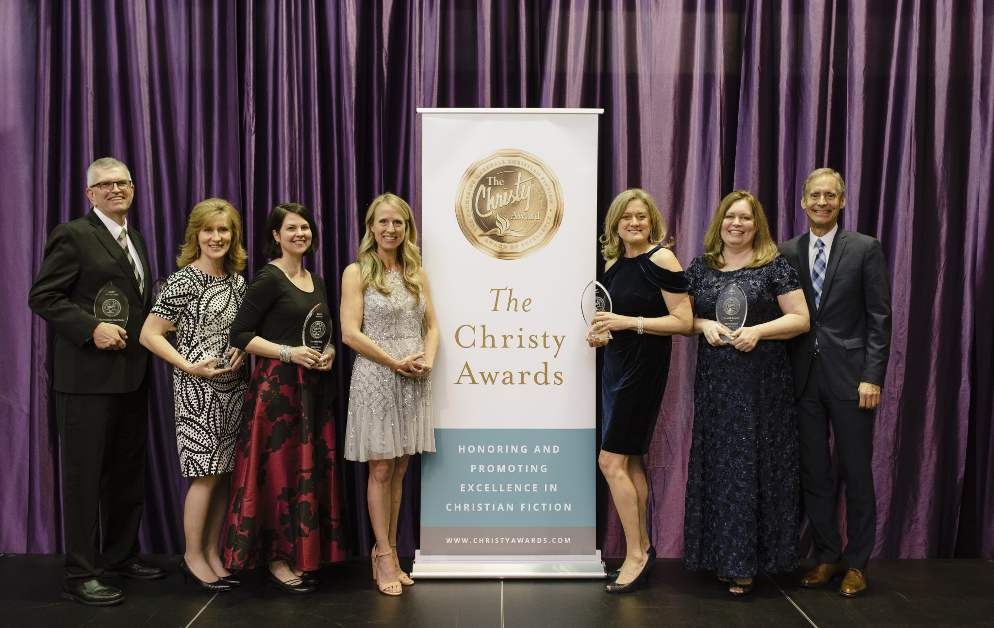 Pictured are the award winning authors present at The Christy Award Gala with ECPA executive director Stan Jantz. (from left to right:) Chris Fabry, Tamera Alexander, Jocelyn Green, Becky Wade, Ann Marie Stewart, Melanie Dickerson, Stan Jantz (photo credit: Kristen Fields)